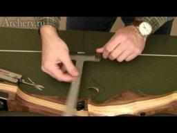 Установка седла для стрелы на тетиве лука